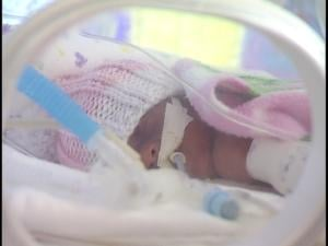 A premature baby in an isolette in the NICU at St. Joseph's Children's Hospital.