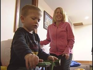 Sara and Griffey play with toys at the Ronald McDonald House