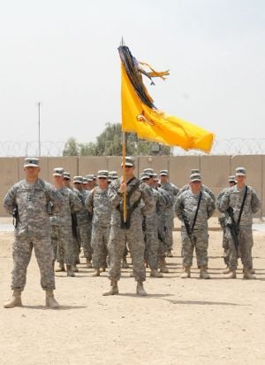 Headquarters Troop, 1-105th Cavalry stands in formation behind the unit's colors at the squadron's transfer of authority ceremony at Camp Cropper. U.S. Army photo by Pfc. Candace Mundt.