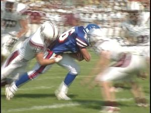 Merrill's Ross VanderGeest pulls tacklers across the goalline in the Jays' win over Antigo
