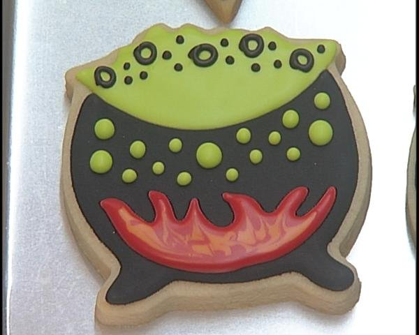 Lowe makes a cookie cauldron come to life with reds, black and green.