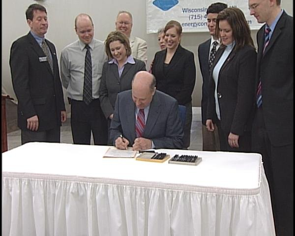 Governor Jim Doyle signs the Recovery Zone Bill