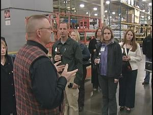 Guests tour the Wausau Homes plant in Rothschild