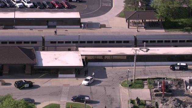 Train conductor shot, suspect in custody near Chicago