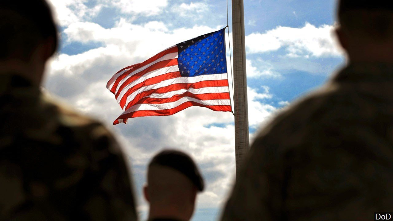 PHOTO: U.S. Troops and the Flag at half mast