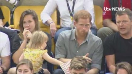 Cheeky toddler steals Prince Harry's popcorn