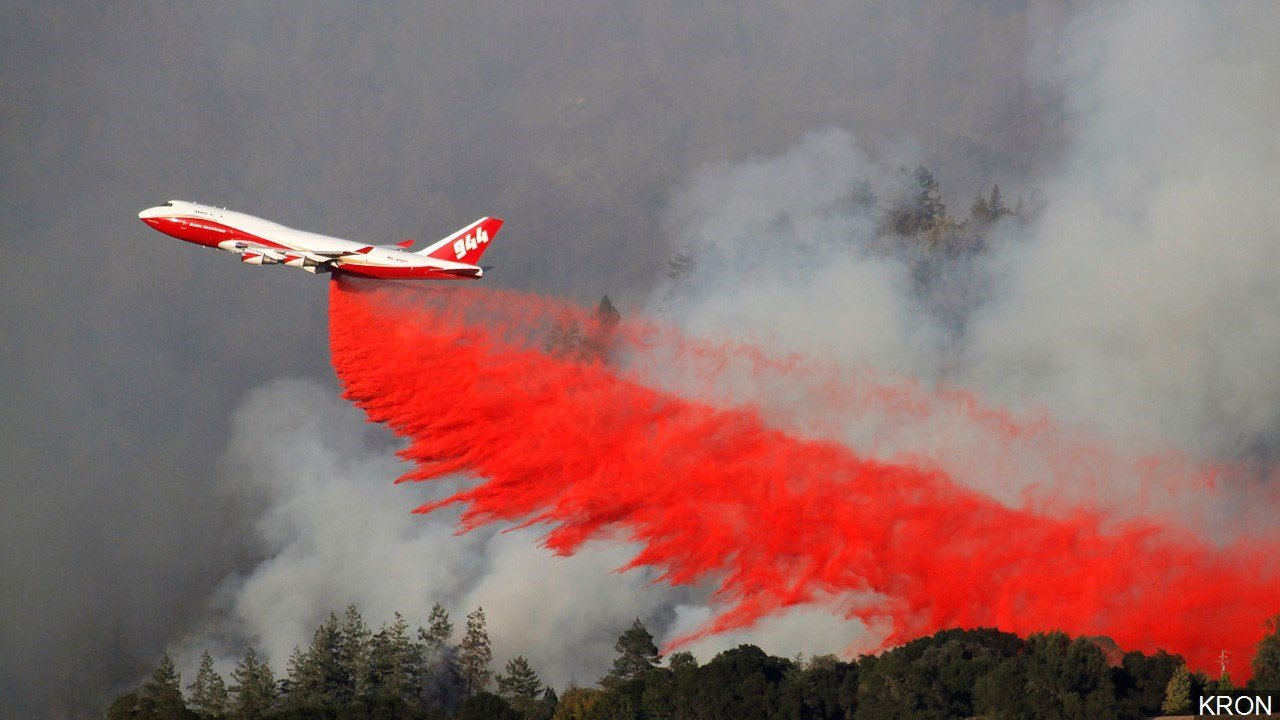 PHOTO: View of the Pocket Fire in Northern California as a 747 Fire Tanker drops a load of fire retardant