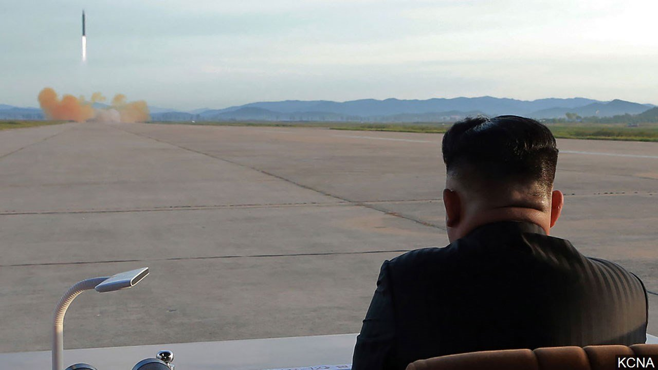 North Korean leader Kim Jong Un watches the launch of a Hwasong-12 missile, Photo Date: 9/16/2017