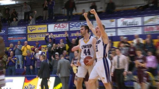 UWSP's leading scorers, Brett Tauber (left) and Mark Nelson (right) celebrate after the final buzzer Wednesday night.