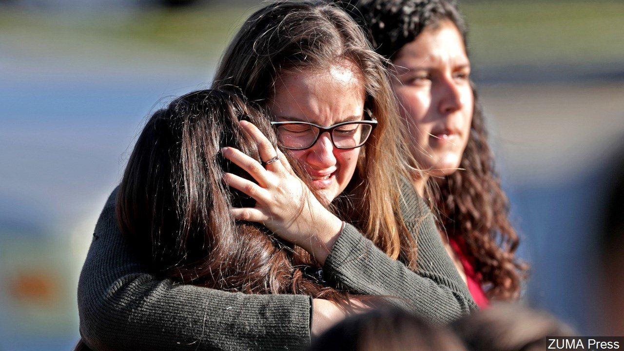 Emotional embrace outside of Marjory Stoneman Douglas High School in Parkland Florida after the School Shooting