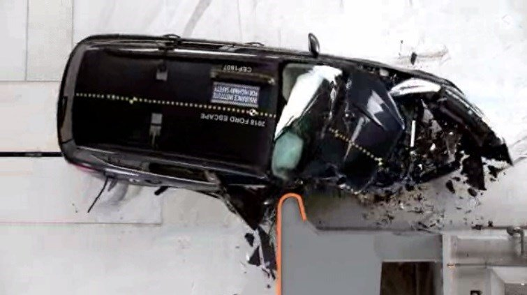 2018 Ford Escape undergoing the Insurance Institute for Highway Safety's passenger side small overlap crash test.