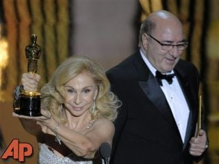 "Dante Ferretti and Francesca Lo Schiavo accept the Oscar for best art direction for ""Hugo."" (AP Photo/Mark J. Terrill)"