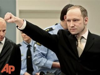 Accused Norwegian Anders Behring Breivik gestures as he arrives at the courtroom, Monday, April 16, 2012 in Oslo, Norway. The terror trial amid worries that he will use the proceedings to showcase his radical views. (AP Photo/Hakon Mosvold Larsen, Pool)