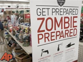In this Monday, Oct. 10, 2011 file photo, a sign promoting zombie preparedness displays in a hardware store in Omaha, Neb. (AP Photo/Nati Harnik, File)