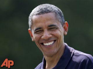 President Barack Obama smiles as he returns to the White House in Washington, Sunday, July 8, 2012, from Camp David, Md. (AP Photo/Manuel Balce Ceneta)
