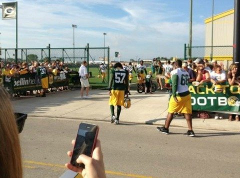 Fans snap photos of Packer players as they walk into training camp.