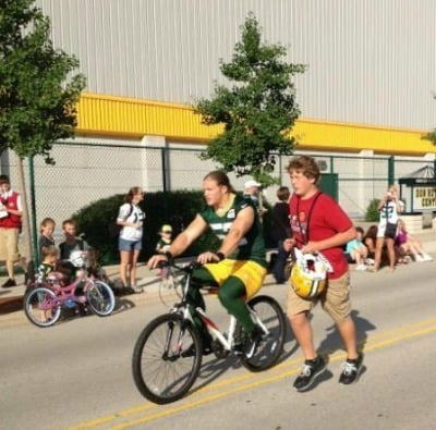 Linebacker Clay Matthews pedals into practice on a pint-sized bike.