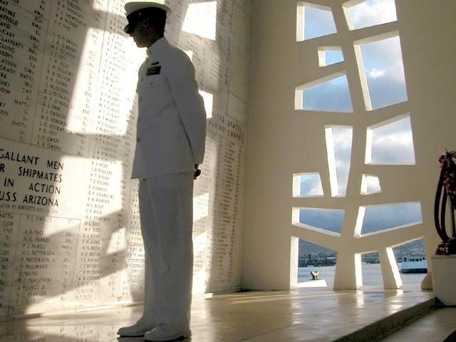 A sailor in the shrine room of the USS Arizona Memorial