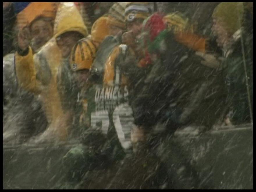 Mike Daniels leaps into the stands after 43-yard touchdown.