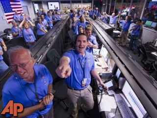 The Mars Science Laboratory team in the MSL Mission Support Area reacts after learning the Curiosity rover has landed safely on Mars, Aug. 5, 2012. (AP Photo/NASA/Bill Ingalls)