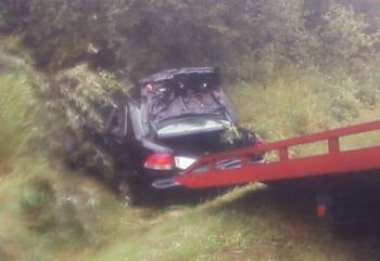 Car being pulled from the ditch
