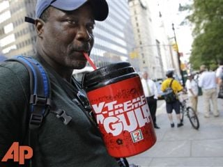 Protester Eric Moore sips on an extra-large beverage during a protest against Mayor Michael Bloomberg, July 9, 2012. (AP Photo/Kathy Willens, File)
