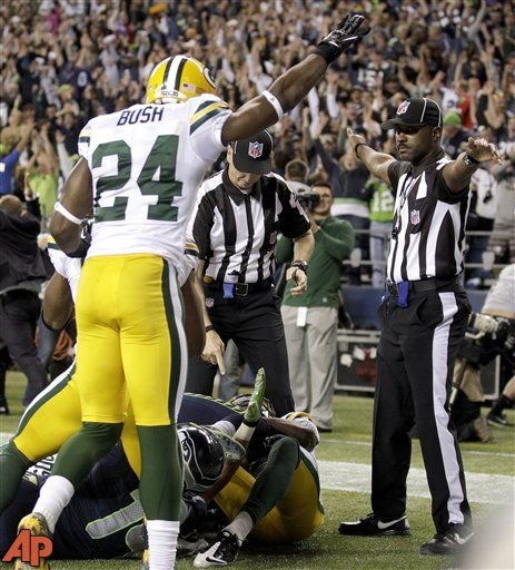 Officials decide on a call for the final play of the game as Green Bay Packers' Jarrett Bush (24) reacts, Sept. 24, 2012. (AP Photo/Stephen Brashear)