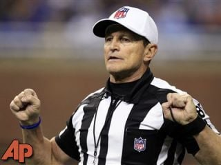 Referee Ed Hochuli signals during a game between the Detroit Lions and the San Diego Chargers in Detroit, Dec. 24, 2011. (AP Photo/Carlos Osorio, File)