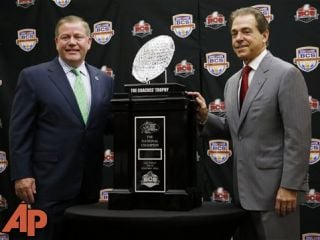 Alabama head coach Nick Saban and Notre Dame head coach Brian Kelly pose with The Coaches' Trophy, Jan. 6, 2013, in Miami. (AP Photo/John Bazemore)
