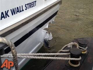 A hole is torn near the bow of the Seastreak Wall Street ferry after it banged into the mooring as it arrived at a pier in New York's financial district Wednesday, Jan. 9, 2013. (AP Photo/Larry Neumeister)
