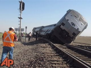 Emergency personnel respond to the scene of a train derailment in Hanford, Calif., Monday, Oct. 1, 2012. At least 20 passengers suffered minor to moderate injuries, authorities said. (AP Photo/Gosia Woznicacka)