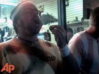 This frame grab made from video on Friday, Oct. 5, 2012, and provided by John-Patrick McNown shows Edward Archbold competing in a roach-eating contest at Ben Siegel Reptile Store in Deerfield Beach, Fla. (AP Photo/Courtesy John-Patrick McNown)