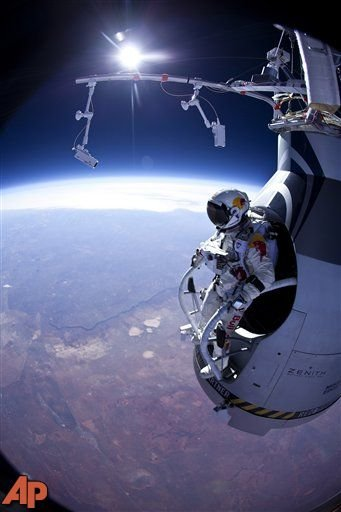 Felix Baumgartner prepares to jump during the first manned test flight for Red Bull Stratos over Roswell, N.M., March 15, 2012. (AP Photo/Red Bull Stratos, Jay Nemeth)