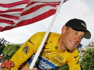 Lance Armstrong carries the United States flag during a victory parade on the Champs Elysees avenue in Paris, July 24, 2005. (AP Photo/Peter Dejong, File)