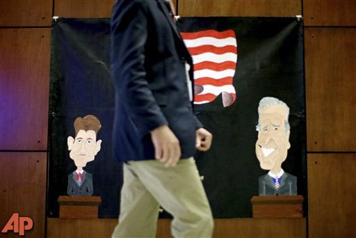 A banner made by a local middle school depicting Republican vice presidential candidate, Rep. Paul Ryan, R-Wis., at left, and Vice President Joe Biden, at right, hangs at Centre College in Danville, Ky. (AP Photo/David Goldman)