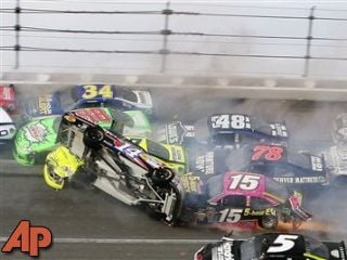 Tony Stewart (14) flips over at the Talladega Superspeedway, Oct. 7, 2012. (AP Photo/Dale Davis)