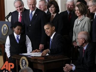 In this March 23, 2010, file photo, President Barack Obama reaches for a pen to sign the health care bill in the East Room of the White House in Washington. (AP Photo/Charles Dharapak, File)