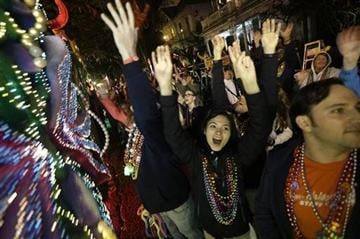 (AP Photo/Gerald Herbert). Revelers yell for beads and trinkets during the Krewe of Orpheus Mardi Gras parade in New Orleans, Monday, Feb. 11, 2013.