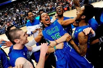 (AP Photo/Michael Perez). Florida Gulf Coast's Sherwood Brown, center, celebrates with teammates after their 81-71 win over San Diego State in a third-round game in the NCAA college basketball tournament, Sunday, March 24, 2013, in Philadelphia.