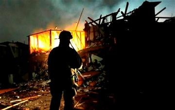 (AP Photo/LM Otero). Firefighters use flashlights to search a destroyed apartment complex near a fertilizer plant that exploded earlier in West, Texas, in this photo made early Thursday morning, April 18, 2013.