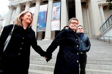 (AP Photo/Jose Luis Magana). Sandy Stier, left, and Kris Perry of Berkeley, Calif., stand outside the National Archives in Washington, Monday, March 25, 2013, before going inside to view the U.S.