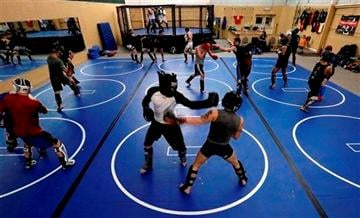 (AP Photo/Paul Sancya). Fighters train at Fight Club Proving Ground gym in Waterford, March 6, 2013.