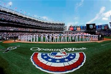 (AP Photo/Matt Slocum). New York Yankees players stand at attention during the national anthem before an opening day baseball game against the Boston Red Sox, Monday, April 1, 2013, in New York.