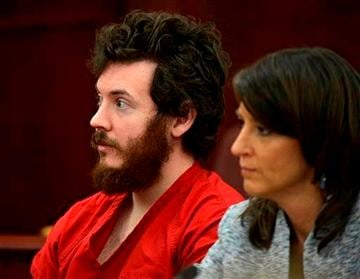 (AP Photo/The Denver Post, RJ Sangosti, Pool, File). FILE - In this March 12, 2013 file photo, James Holmes, left, and defense attorney Tamara Brady appear in district court in Centennial, Colo. for his arraignment.