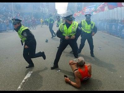 Scene at Boston explosions. John Tlumacki photo Photo Credit: Boston Globe Sports via Twitter