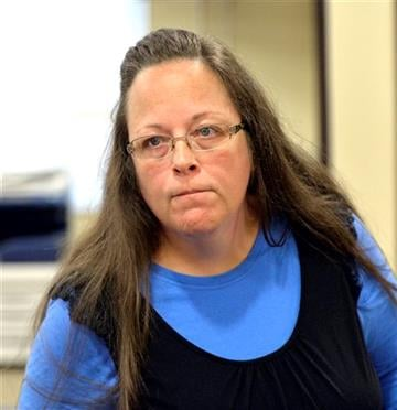 (AP Photo/Timothy D. Easley). Rowan County Clerk Kim Davis listens to a customer following her office's refusal to issue marriage licenses at the Rowan County Courthouse in Morehead, Ky., Tuesday, Sept. 1, 2015.