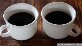 Cups of delicious coffee