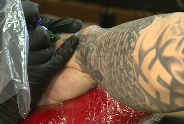 Platteville tattoo shop removing hateful tattoos for free for Tattoo shops in wisconsin
