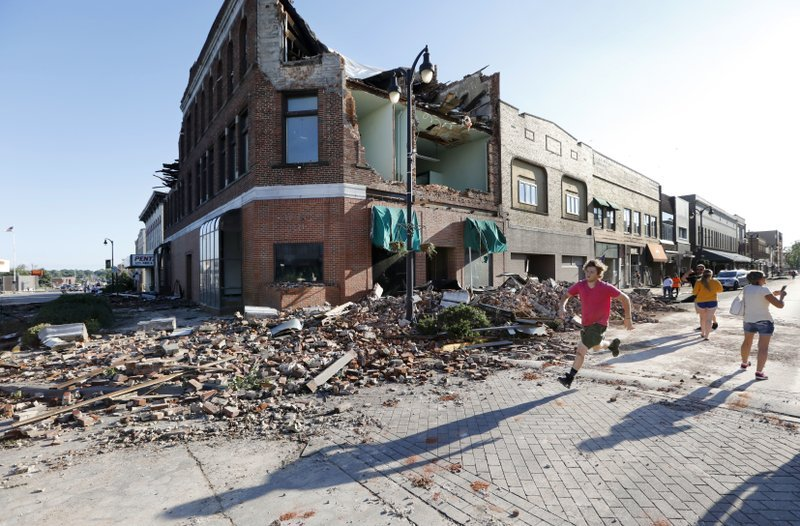 Some of the damage caused by a tornado in Marshalltown, IA (AP)